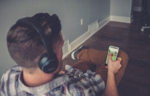 A man listening to an audiobook